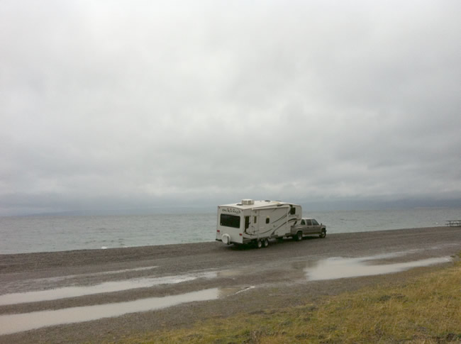 Fifthwheel RV and truck on the beach of Yellowstone Lake. A huge lake at 7,500 feet elevation.