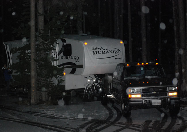 Fifthwheel RV camping in the snow in Yellowstone National Park at Grant Village campground.