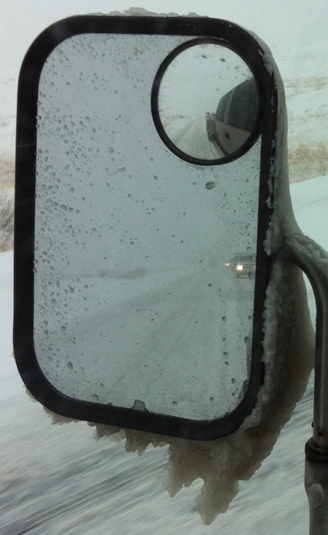 Image of ice building up on the towing mirror of our RV towing truck.