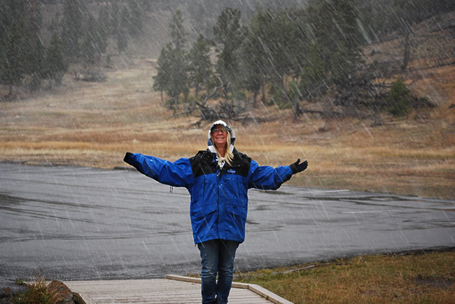 Carolyn enjoying the snow in the geyser fields in Yellow Stone NP. Firehole loop road.